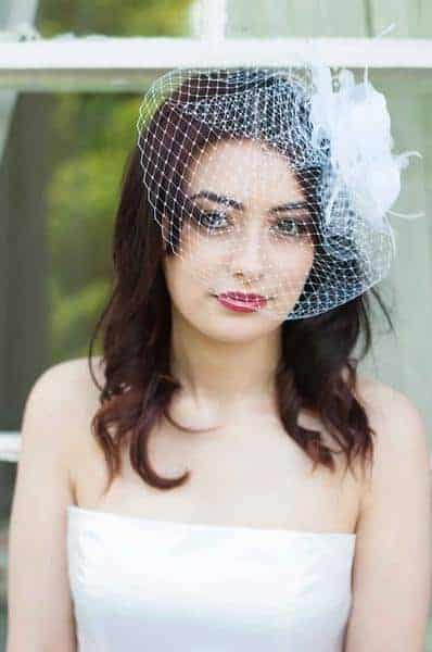 french netting visor veil with feather flowers